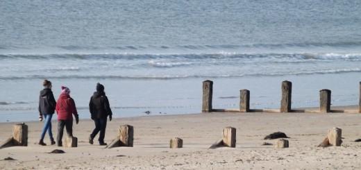 Walkers on beach copyright Karen Cropper